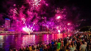 Revellers watch fireworks above Brisbane.