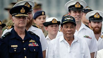Philippines President Rodrigo Duterte with Australian Defence Force Chief Air Chief Marshal Mark Binskin aboard HMAS Adelaide. (Photo: AAP).