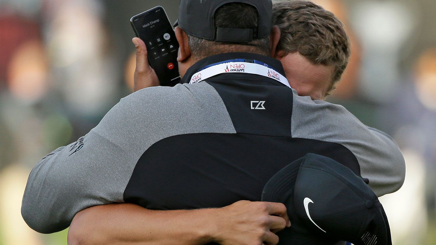 Cameron Champ embraces his father after winning the Safeway Open.