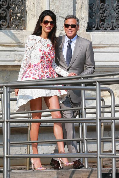 While not a red carpet shot, we can't go past this look. George Clooney and Amal, in Giambattista Valli, at Hotel Cipriani in Venice, September, 2014