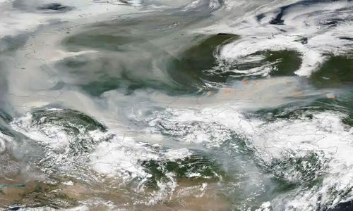 An image released by Nasa shows smoke from hundreds of forest fires covering most of Russia.