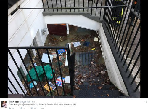 Mr Rock's stairwell looks more like a grubby metropolitan drain after his home was swamped by deluge. Source: Twitter