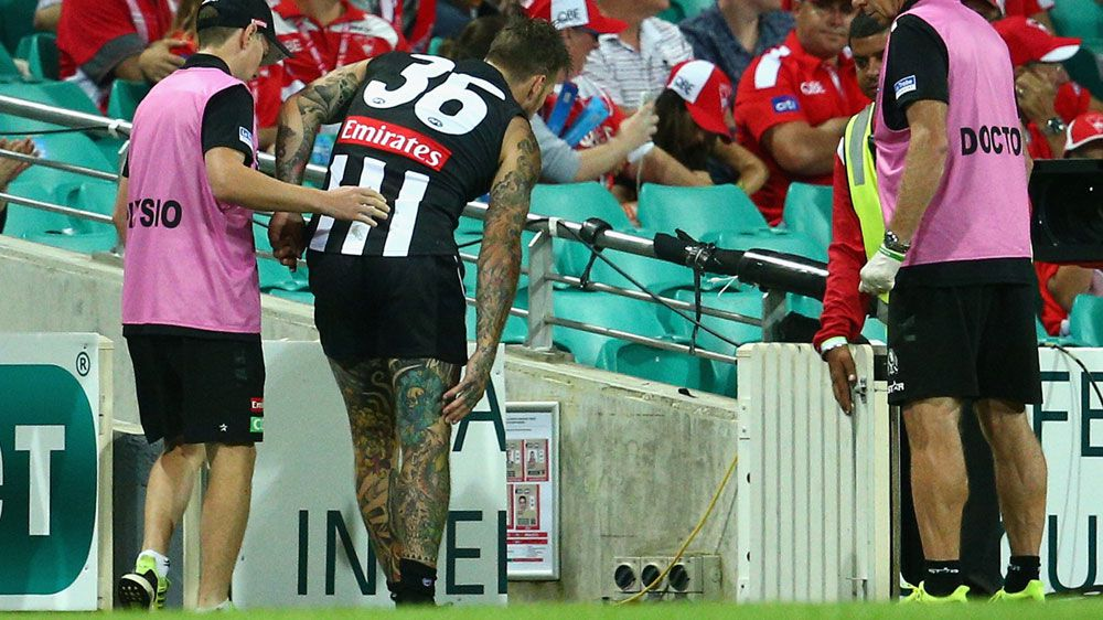 Dane Swan hobbles off the ground after injuring himself against Sydney. (Getty)