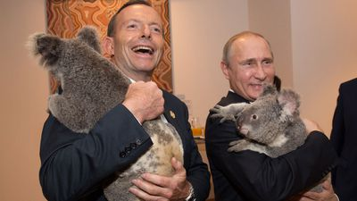 <b>The lighter moments of the G20 retreat:</b> Australian Prime Minister Tony Abbott cuddles up to a koala with Russia's President Vladimir Putin showing his softer side. (Getty Images)