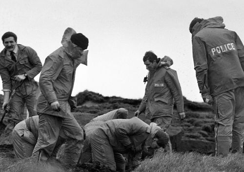Police scour Saddleworth Moor for victims' bodies.