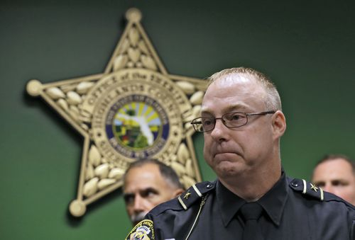 Sebring Police Chief Karl Hoglund reacts as he listens to a question during a news conference