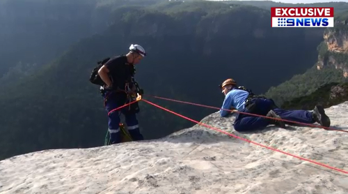 Paramedic Damon Anderson carefully scaled down the 30 metre cliff edge to stabilise Isaac before the rescue chopper arrived.