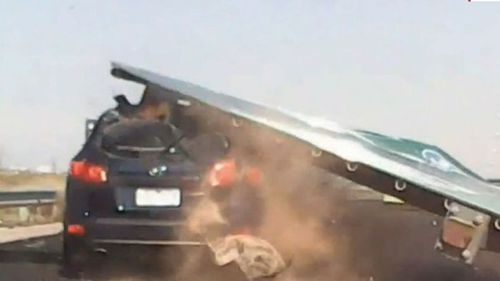 The four-tonne sign crushed the 53-year-old's car with the mother of three lucky to make it out alive.