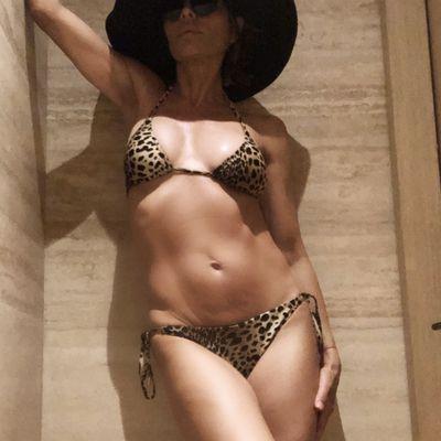 171af5eba60c Lisa Rinna strikes a pose in leopard bikini
