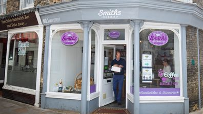 Prince William, Duke of Cambridge carrying baked goods and pastries as he leaves Smiths the Bakers, in the High Street on June 19, 2020 in King's Lynn, Norfolk