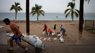 Puerto Vallarta residents rushed to fill sandbags before the hurricane made landfall. (AAP)