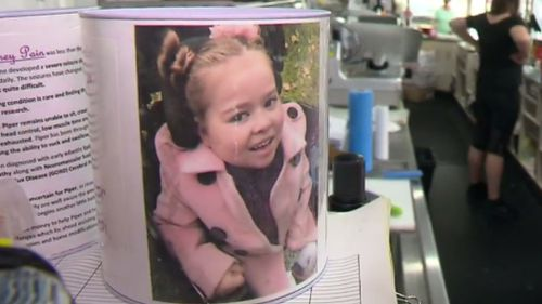 The charity tins raise funds for sick children including Piper Pain. (9NEWS)