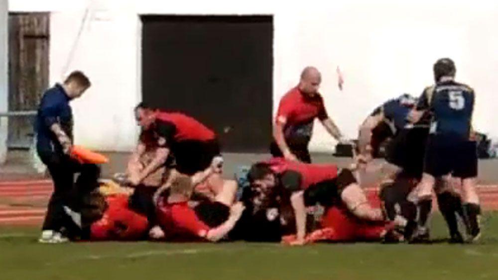 Rugby linesman kicks defenceless player
