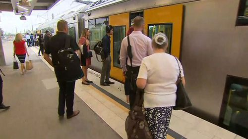 Passengers wait for a train at Schofields. (9NEWS)