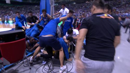 The fight then pushed into the crowd, where Goulding found himself under a pack of around 10 Filipino players and staff. Picture: Fox News
