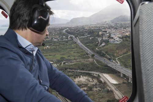 Italian Premier Giuseppe Conte surveyed the damaged areas of Sicily by helicopter.
