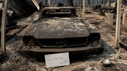 "A sign that reads ""Heart broken"" is displayed in front of a destroyed vehicle at Coleman Creek Estates mobile home park in Phoenix, Ore., Thursday, Sept. 10, 2020. The area was destroyed when a wildfire swept through on Tuesday, Sept. 8. (AP Photo/Paula Bronstein)"