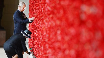 The Royals walk along the Roll of Honour and place a poppy on the Wall of Remembrance following the Remembrance Day service at the Australian National War Memorial in Canberra. (AAP)