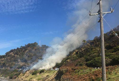 Police have begun a controlled burn on the Great Ocean Road. (Victoria Police)