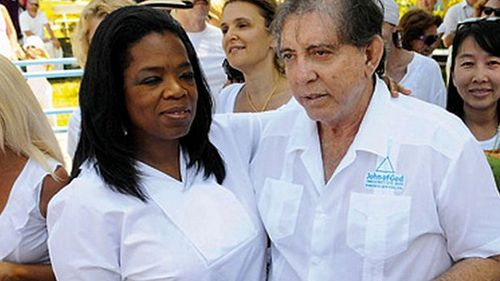 """In 2012 Oprah Winfrey traveled to visit de Faria to record a special for her talk show, Super Soul Sunday. She told Brazilian media at the time that the experience was overwhelming. """"It was so strong that I had to sit down because I felt like I was going to pass out,"""" she told Band TV Goiania."""