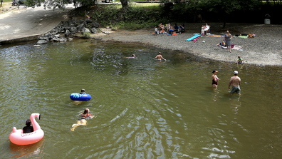 People take a dip in Squirrel Creek at Western Gateway Park in Penn Valley, Calif., Tuesday afternoon, May 26, 2020, as temperatures climbed to the mid-90s. (Elias Funez/The Union via AP)