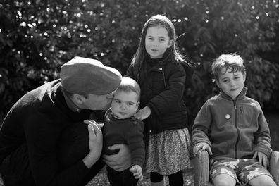 Undated handout photo issued by Kensington Palace on Wednesday Dec. 25, 2019 of Britain's Prince William with his children Prince Louis, Princess Charlotte and Prince George taken in Norfolk earlier this year by his wife Kate, Duchess of Cambridge. (Kate, The Duchess of Cambridge via AP)