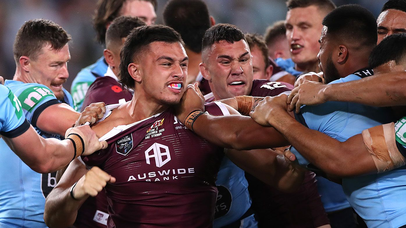 Tino Fa'asuamaleaui of the Maroons and Payne Haas of the Blues scuffle during game two of the 2020 State of Origin series
