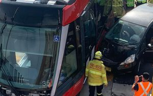 Sydney tram delays after car crashes into tram in Surry Hills