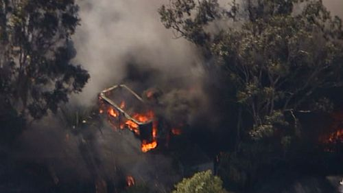 Fire consumes a building in a blaze near Penrith, in Sydney's west. (9NEWS)