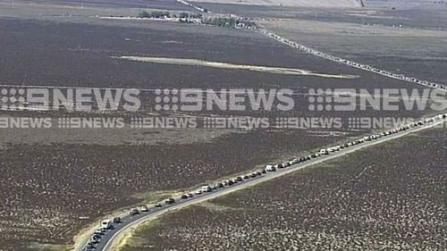 The intersection of the Copper Coast Highway and National Highway 1 heading south from the Yorke Peninsula is packed with cars.