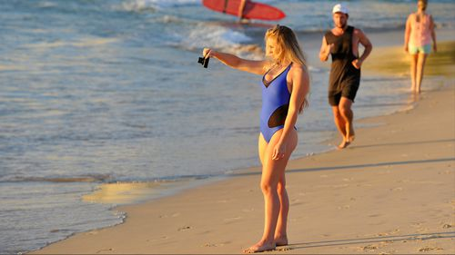 Adelaide is set to sweat through the night with temperatures staying in the 30s. (AAP)