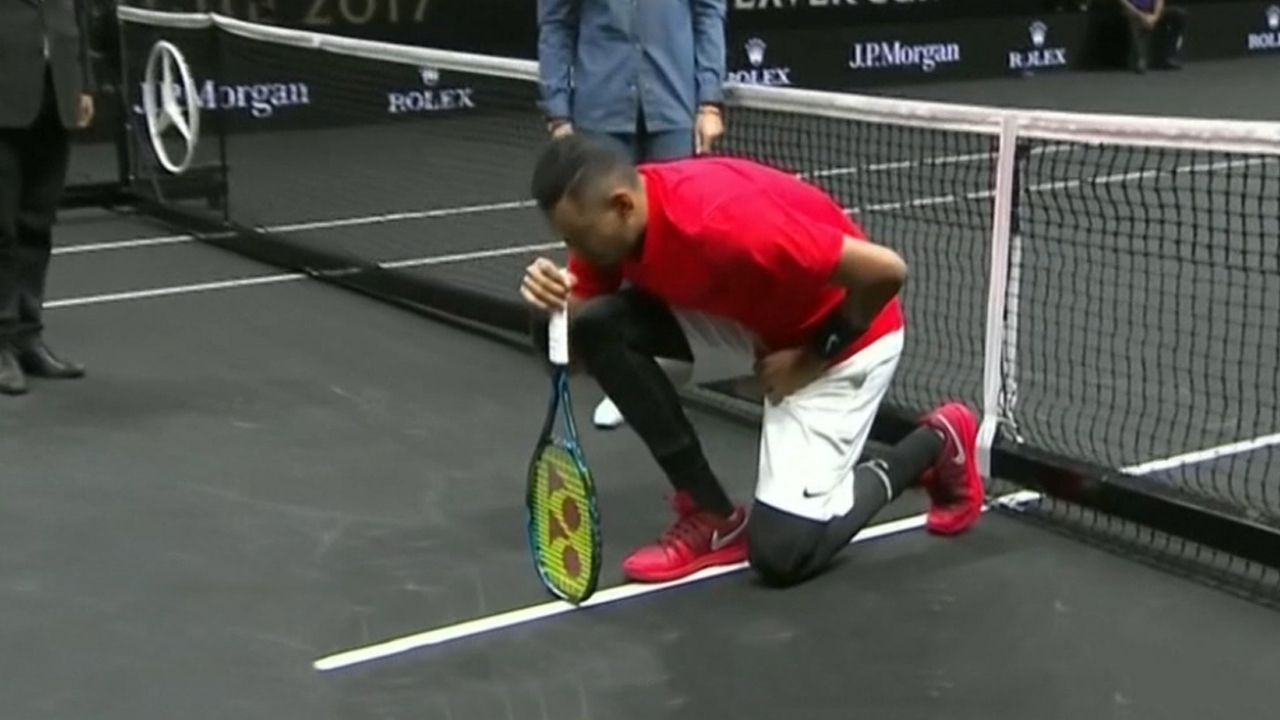 Kyrgios takes knee before loss to Federer