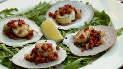 """<a href=""""http://kitchen.nine.com.au/2016/05/05/15/40/grilled-scallops-on-the-shell-with-sucuk-coriander-and-lemon"""" target=""""_top"""">Grilled scallops on the shell with sucuk, coriander and lemon recipe</a> - a perfect dish as a starter entree, or as a dainty bite as part of a bigger romantic spread -"""