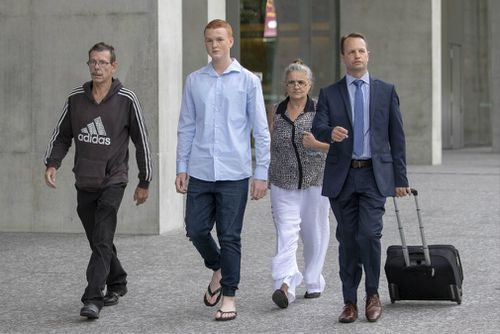 Ryan Hodson (second left) leaves court with supporters and his lawyer. Picture: AAP