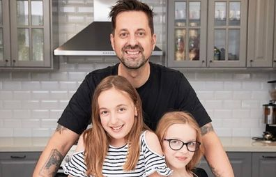 George 'Lunchbox Dad' with his daughters.