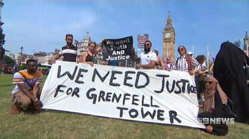 Protesters clash with police in London over Grenfell tower fire