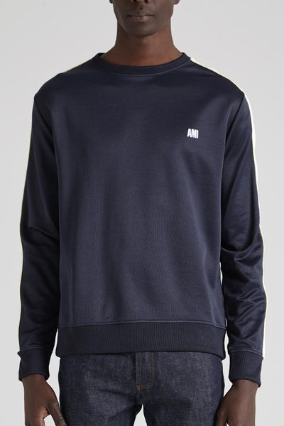 """<a href=""""https://www.incu.com/products/ami-track-sweatshirt-navy"""" target=""""_blank"""" title=""""AMI Track Sweatshirt in Navy, $310"""" draggable=""""false"""">AMI Track Sweatshirt in Navy, $310</a>"""