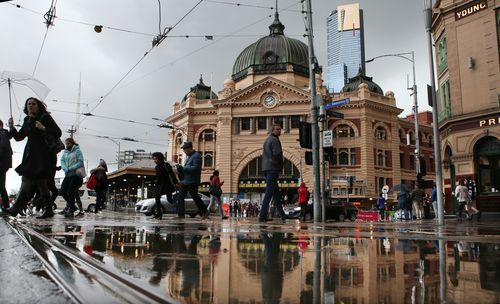 Soggy scenes in the CBD this morning. (AAP)