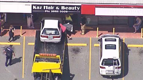 A car crashed into a shop at Bray Park, north of Brisbane. (9NEWS)