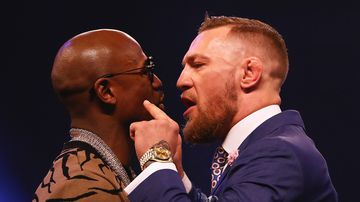 Floyd Mayweather Jr. and Conor McGregor come face to face during the Floyd Mayweather Jr. v Conor McGregor World Press Tour at SSE Arena on July 14, 2017 in London, England. (Getty)