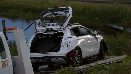 The bodies of two men were pulled from the car.