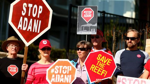 Protesters are seen during a Stop Adani Protest at Lady Martin's Beach, Point Piper in May 2018. Picture: AAP