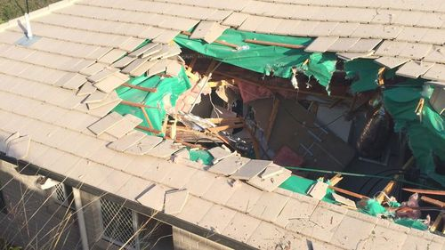 A car has ploughed through the roof of a home northwest of Brisbane. (9NEWS)
