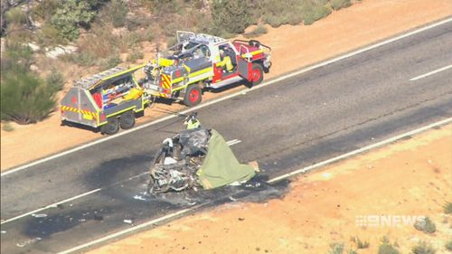 The car was hit after a truck blew a tyre and crossed to the wrong side of the road. (9NEWS)