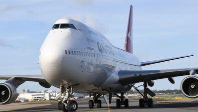 Qantas jet lands.