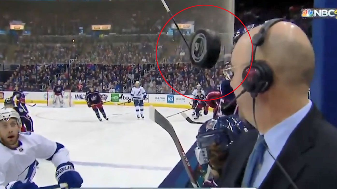 Hockey Puck Barely Misses Reporter, Crashes Into Camera