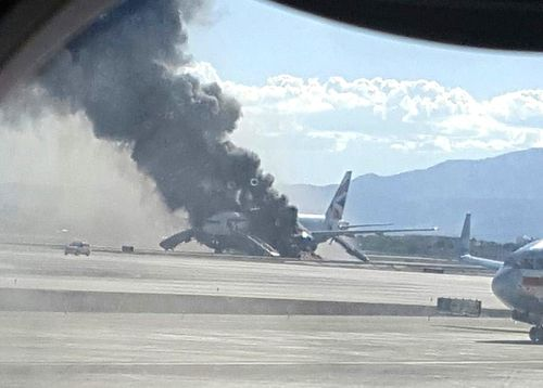 Black smoke billows from the plane. (Image: Eric Hays)