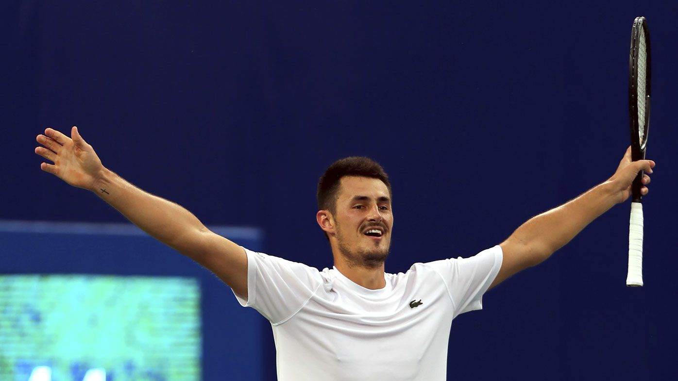 Bernard Tomic wins first ATP title in three years
