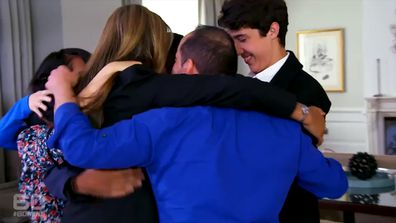 A group of Lindt Cafe siege survivors all hug as they meet during a reunion while filming for 60 Minutes.