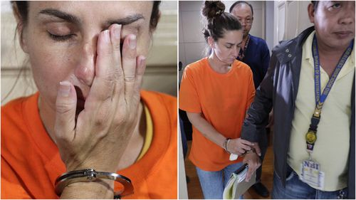 The 43-year-old was paraded in front of local media in Manila yesterday, sporting an orange detainee shirt with her hands in cuffs.